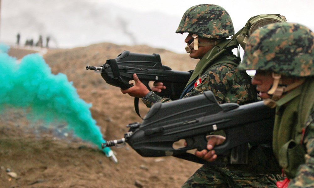 Peruvian marines carrying F2000 assault rifles assault a beach with service members from 10 nations during a large-scale multinational amphibious beach assault in Ancon, Peru, July 19, 2010. U.S. Marines were deployed in support of operation Partnership of the Americas/Southern Exchange, a combined amphibious exercise with maritime forces from Argentina, Mexico, Peru, Brazil, Uruguay and Colombia. (U.S. Marine Corps photo by Cpl. Brian J. Slaght/Released)